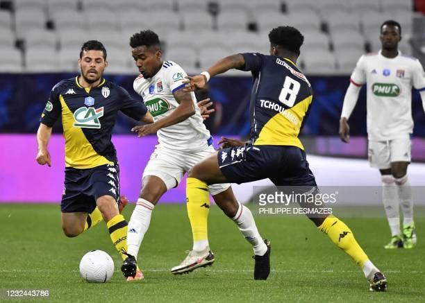 Graphic content / Lyon's Brazilian midfielder Thiago Mendes fights for the ball with Monaco's French midfielder Aurelien Tchouameni and Monaco's...