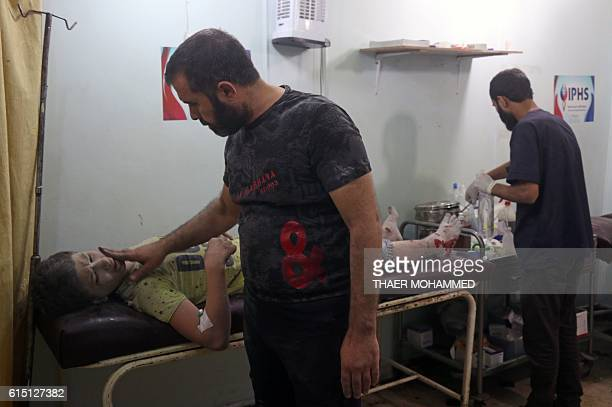 Graphic content / Maarouf a 12yearold Syrian boy receives treatment at a hospital after being rescued from the rubble of a building following a...