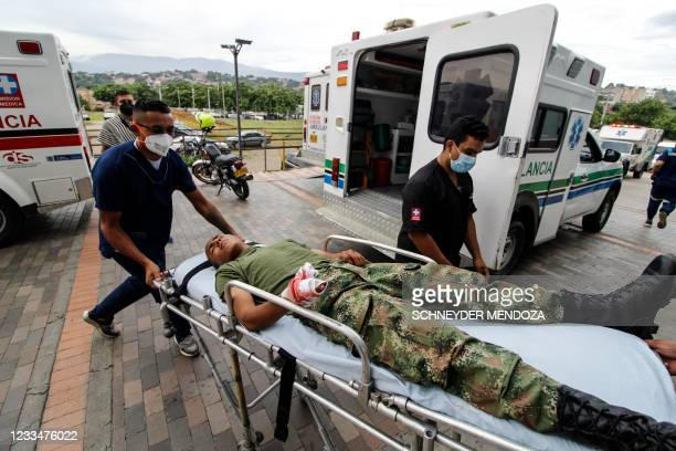Graphic content / Medical workers bring an injured soldier on a stretcher in a hospital following a explosion in Cucuta, Colombia, on the border with...