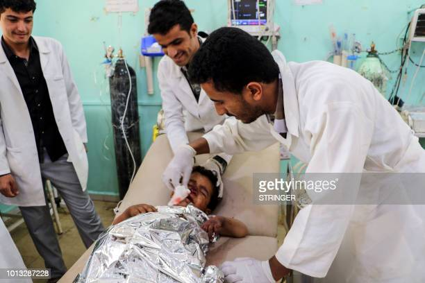 Graphic content / Medics treat a Yemeni child who was injured in a reproted air strike at an emergency clinic in the Iranbacked Huthi rebels'...
