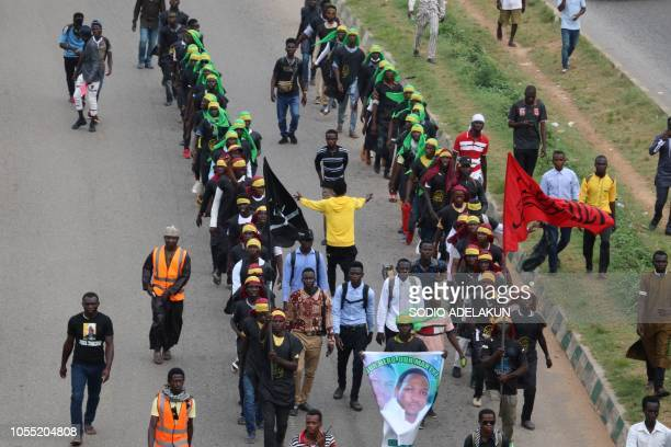 Graphic content / Members of Islamic Movement of Nigeria wave flags and chant slogans as they take part in a demonstration to protest against an...