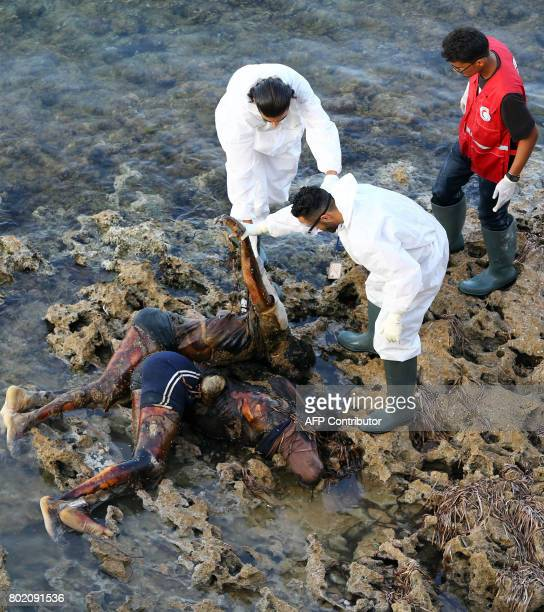 Graphic content / Members of Libya's Red Crescent recover the bodies of migrants that washed ashore in Tajura a coastal suburb of the Libyan capital...