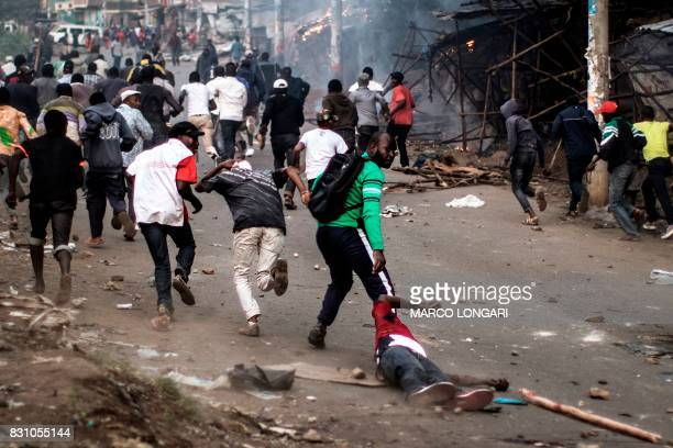 Graphic content / Members of the Kikuyu ethnic group residents of Mathare have to leave behind the body of a fellow Kikuyu man who was beaten and...