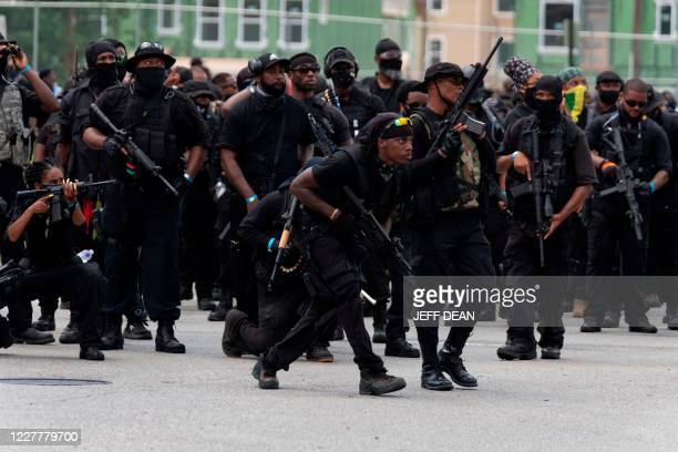 Graphic content / Members of the Not Fucking Around Coalition an all black militia march during a rally to protest the killing of Breonna Taylor in...
