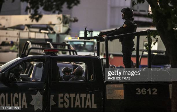 Graphic content / Mexican police patrol in a street of Culiacan state of Sinaloa Mexico on October 17 after heavily armed gunmen in fourbyfour trucks...