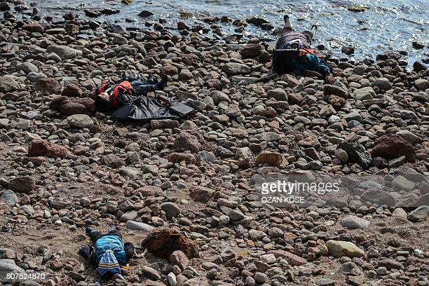 Graphic content / Migrants bodies are washed up on a beach in Canakkale's Bademli district on January 30 2016 after at least 33 migrants drowned when...