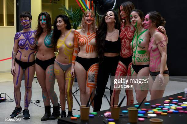 Graphic content / Models pose with Spanish artist Claudia Sahuquillo after a body paint workshop during a workshop at the Barcelona 080 Fashion Week...