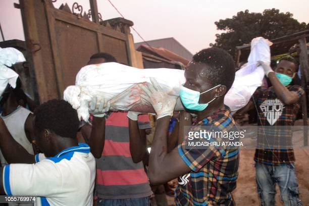 Graphic content / Mourners carry corps as they prepare to bury alleged victims of the violent clashes in Abuja between Nigeria police and members of...