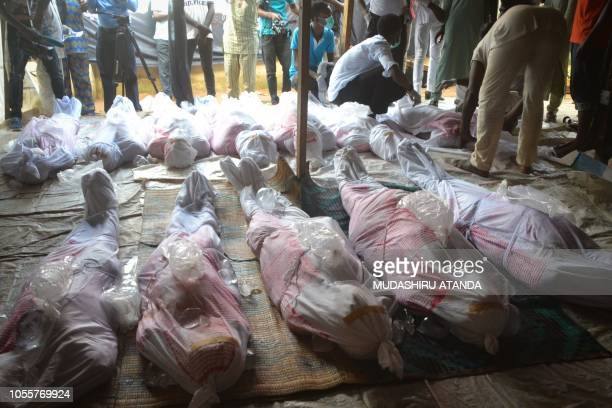Graphic content / Mourners prepare to bury alleged victims of the violent clashes in Abuja between Nigeria police and members of the Islamic Movement...
