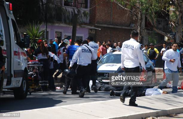 Graphic content / Municipal police officers and paramedics arrive at the scene where other police officers were killed during an armed attack in...