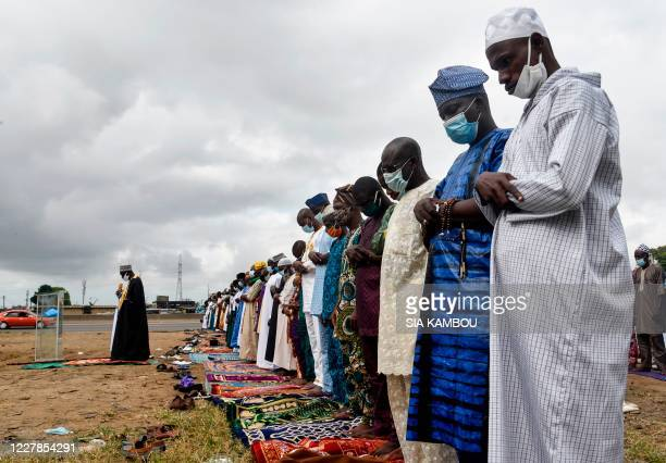 Graphic content / Muslim faithfuls pray during the Muslim Eid alAdha known as Tabaski in Western Africa in Yopougon district in Abidjan on July 31...