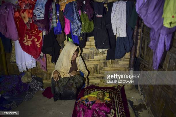 Graphic content / Myanmar Rohingya migrant Nur Begum looks at the dead body of her sixmonthold son Alam in a refugee camp in Teknaf in Bangladesh's...