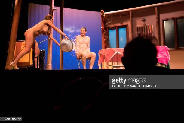 Graphic content / Naked actors perform during the nudist play nu et approuve at the Palais des Glaces theatre in Paris on January 20 2019