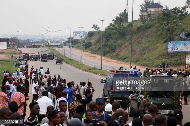 Graphic content / Nigerian soldiers arrive on the site of the clashes between soldiers and members of Islamic Movement of Nigeria following a...