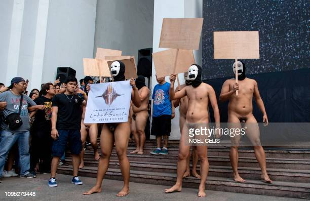 Graphic content / Nude members of a fraternity participate in the 'Oblation Run' at the University of the Philippines campus in suburban Manila on...