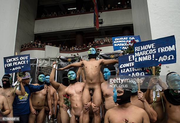 Graphic content / Nude members of a university fraternity participate in a 'Oblation Run' to protest against the burial of the late dictator...