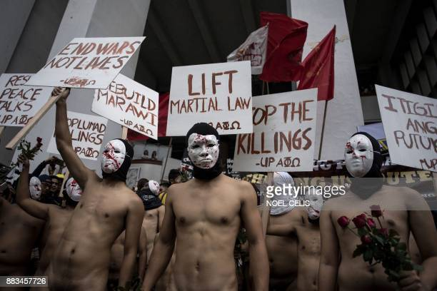 Graphic content / Nude members of a university fraternity participate in a Oblation Run to protest against the government's war on drugs campaign and...
