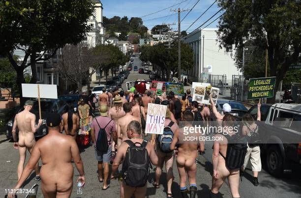 Graphic content / Nudists march along during the Nude Love Parade in San Francisco California on March 17 2019 Dozens of nudists paraded through San...