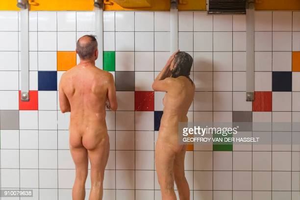 Graphic content / Nudists take a shower after a swim lesson at the Roger Le Gall swiming pool on January 12 2018 In this pool some hours are reserved...