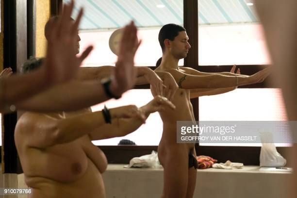 Graphic content / Nudists take part in a yoga lesson at the Roger Le Gall swimming pool in Paris on January 12 2018 Every week some hours are...