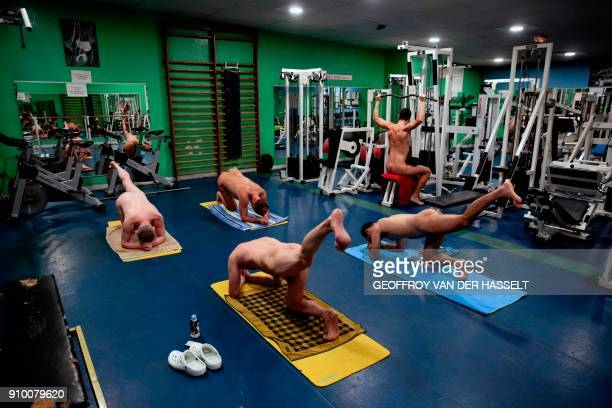 Graphic content / Nudists take part in muscle building training at the Roger Le Gall swimming pool in Paris on January 12 2018 Every week some hours...