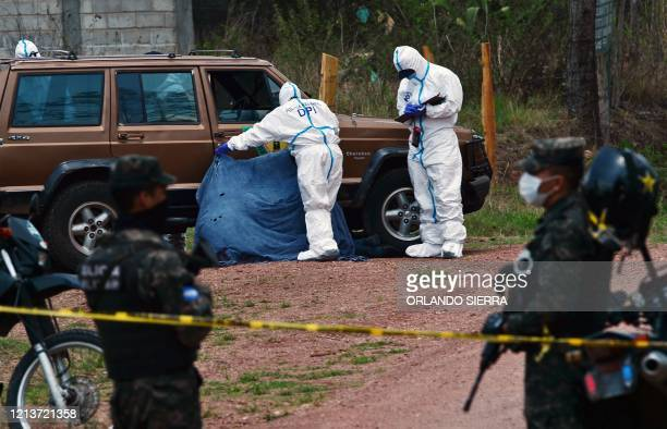 Graphic content / Officers of the Criminal Investigation Unit wearing protective suits to avoid possible contagion with the novel coronavirus,...