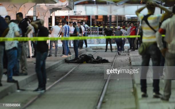 Graphic content / Onlookers gather at the scene outside a metro station where a man reportedly wearing an explosive belt blew himself up in the early...