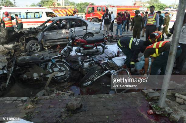 Graphic content / Pakistani rescue workers move the bodies of victim at the site of an explosion in Lahore on July 24 2017 An explosion killed at...