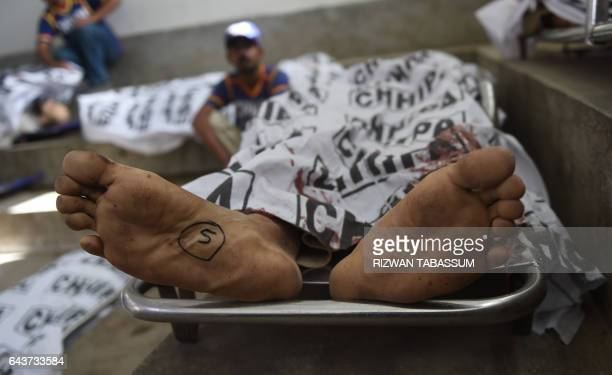 Graphic content / Pakistani volunteers gather near the bodies of suspected Talibanlinked militants who were killed in a raid by security forces at a...