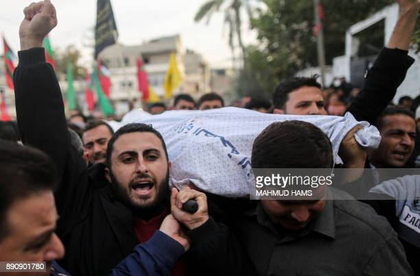 Graphic content / Palestinians attend the funeral of a Palestinian Islamic Jihad militant following a reported Israeli strike in Beit Lahia in the...