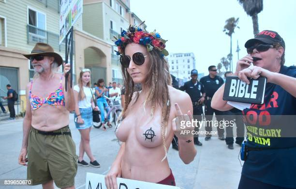 Graphic content / Participants and onlookers gather for Go Topless Day celebrating its 10th anniversary in Venice Beach California on August 26 2017...