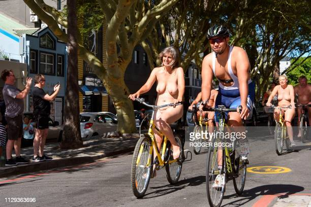 Graphic content / Participants take part in the annual Naked Bike Ride in Cape Town on March 9 2019 The event was organised to raise awareness for...