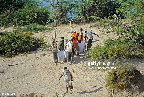 Graphic content / People carry the bodies of two Somalian men convicted of murdering a Somali journalist Abdirizak Mohamed Barow and Hassan Nur Ali...