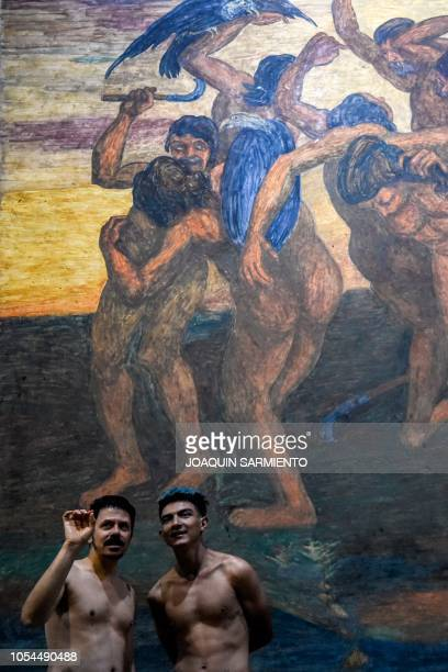 Graphic content / People discuss a piece by Colombian artist Pedro Nel Gomez during a special guided nudist visit of the exhibition The nude manifest...