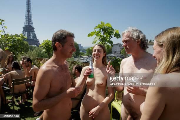 Graphic content / People enjoy a drink on the terrace of the Palais de Tokyo after a nudist visit of the Discorde Fille de la Nuit season exhibition...