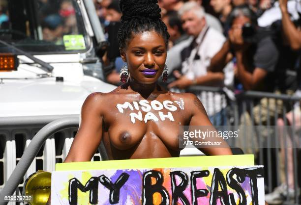Graphic content / People participate in a march during International Go Topless Day in New York August 26 2017 an annual event held in cities around...