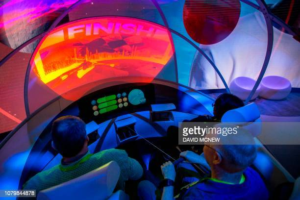 Graphic content / People practice rowing in a demonstration of the Hyundai My IA system of passenger entertainment in autonomous vehicles at the Las...