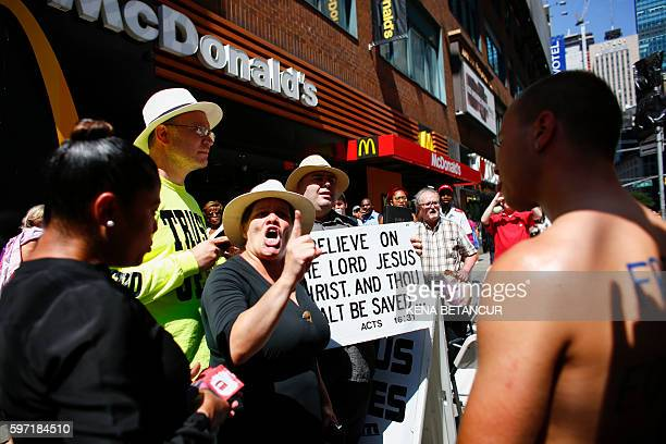 Graphic content / People protest participants in the GoTopless Pride Parade on August 28 2016 in New York Women around the US are going topless in...