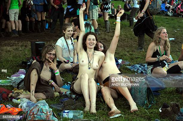 Graphic content / People react during the Glastonbury Festival of Music and Performing Arts on Worthy Farm near the village of Pilton in Somerset...