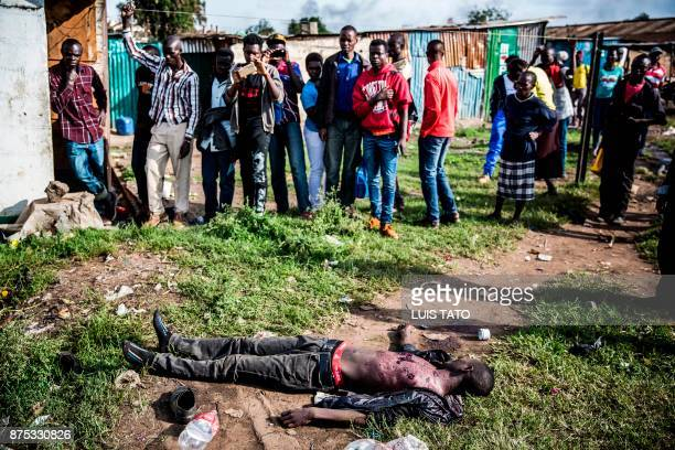 Graphic content / People surround the body of a man allegedly was shot dead by police during a demonstration by Kenya's opposition party National...