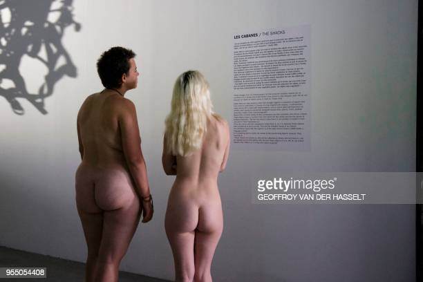 Graphic content / People take part in a nudist visit of the Discorde Fille de la Nuit season exhibition at the Palais de Tokyo museum in Paris on May...