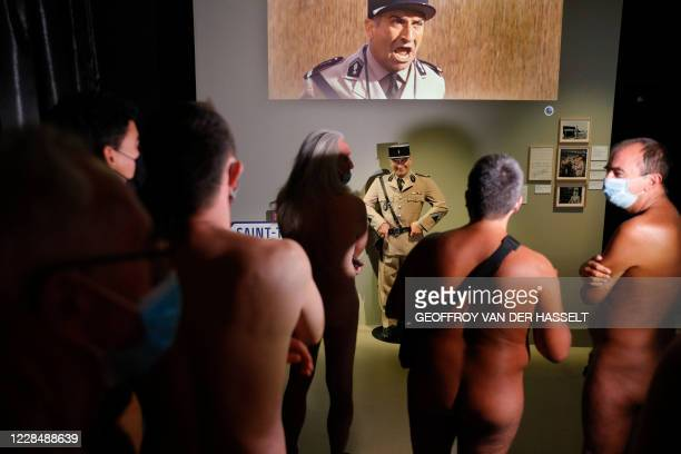 Graphic content / People take part in a nudist visit of the 'Louis de Funes' exhibition at the Cinematheque museum in Paris on September 13 2020