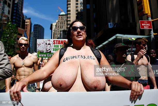 Graphic content / People take part in the GoTopless Pride Parade on August 28 2016 in New York Women around the US are going topless in celebration...