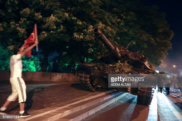 Graphic content / People try to take over a tank in Ankara Turkey during a protest against military coup on July 16 2016 42 dead in Ankara coup...