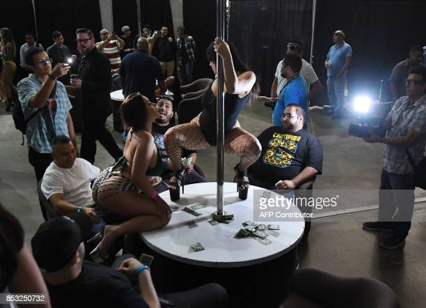 Graphic content / Performers meet with fans during the annual 'AdultCon' Adult Entertainment Convention in Los Angeles California on September 24...