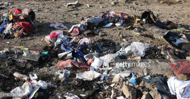 Graphic content / Personal belongings and debris are pictured scattered on the ground after a Ukrainian plane carrying 176 passengers crashed near...