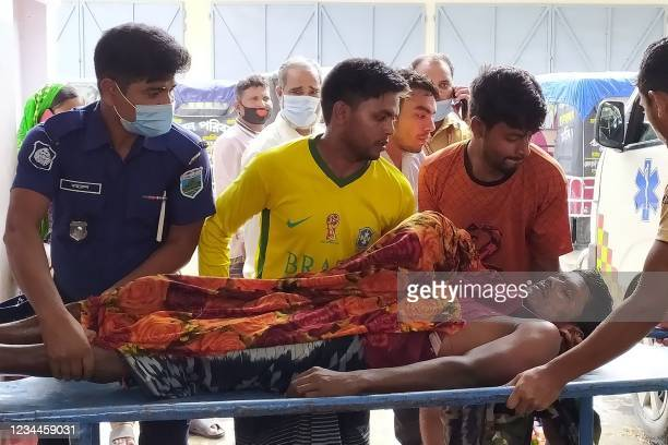 Graphic content / Police and relatives transport the body of a victim who died in a lightning strike in Chapai Nawabganj district, about 300 km from...
