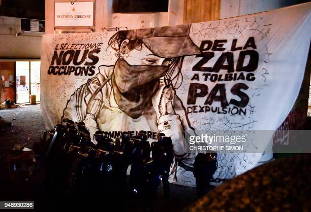 Graphic content / Police break up a protest camp at the Tolbiac campus part of the Sorbonne University in front of a banner reading 'They select we...