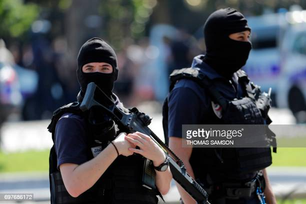 Graphic content / Police officers patrol the ChampsElysees avenue on June 19 2017 in Paris after a car crashed into a police van before bursting into...