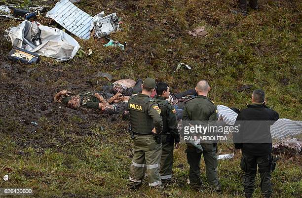 Graphic content / Police officers work in the recovery of the bodies of victims of the LAMIA airlines charter that crashed in the mountains of Cerro...